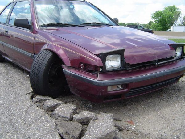 Lansing pothole car damage repair