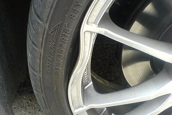Pothole wheel rim damage Lansing MI